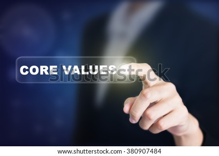 Businessman pressing a CORE VALUES concept button. Can be used in advertising. - stock photo