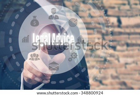 Businessman pressing a Legal Advice concept button. - stock photo
