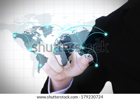 Businessman pressing a modern world map connecting