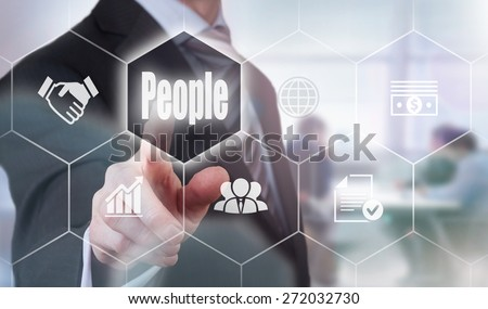 Businessman pressing a People concept button. - stock photo