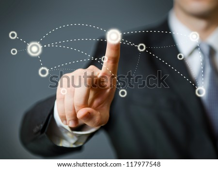 Businessman pressing a spot in the air - stock photo