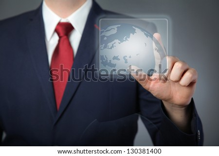Businessman pressing a virtual button - stock photo