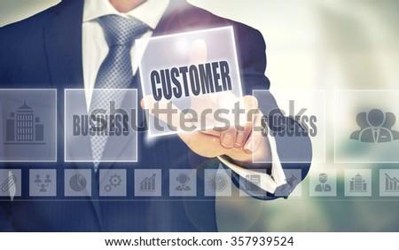 Businessman pressing an Customer concept button. - stock photo