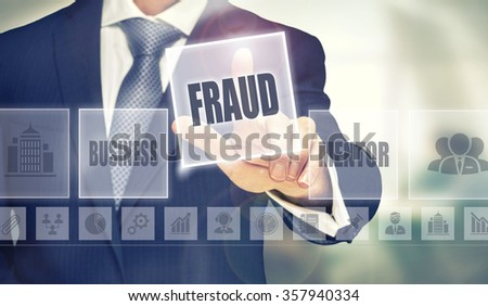 Businessman pressing an Fraud concept button. - stock photo