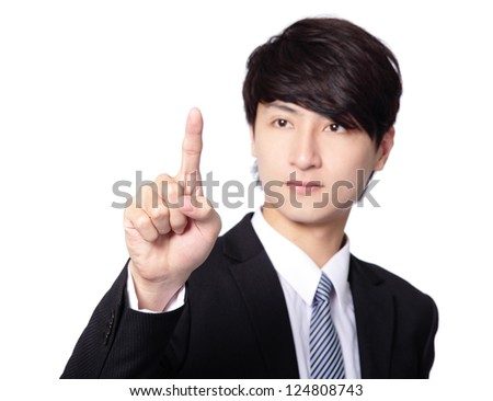 Businessman pressing an imaginary button isolated on white background, asian model