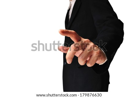 Businessman pressing an imaginary button on white background with clipping path - stock photo