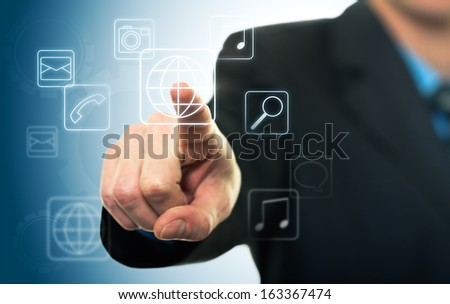 Businessman pressing application button on computer with touch screen - stock photo
