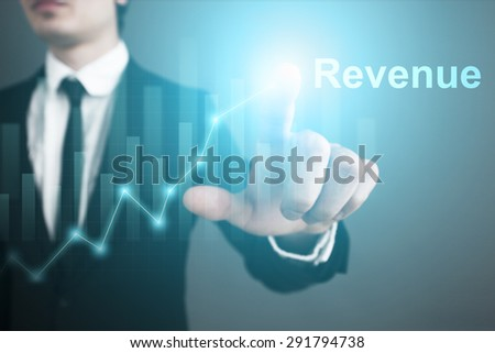 Businessman pressing button on touch screen interface and press button revenue.   business concept. - stock photo