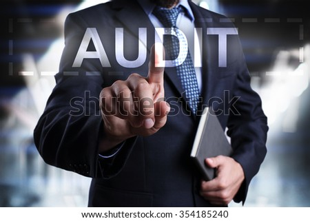 """Businessman pressing button on touch screen interface and select """"Audit"""". Business concept. Internet concept. - stock photo"""