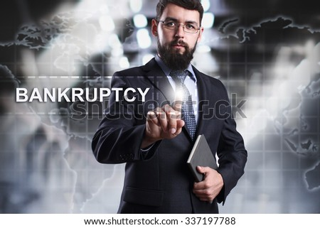 Businessman pressing button on touch screen interface and select Bankruptcy. Business concept. Internet concept. - stock photo