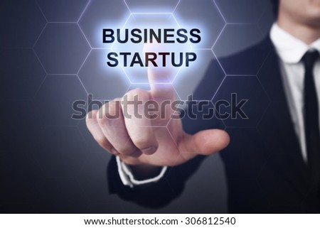 "Businessman pressing button on touch screen interface and select ""Business startup"". Business concept. Internet concept. - stock photo"