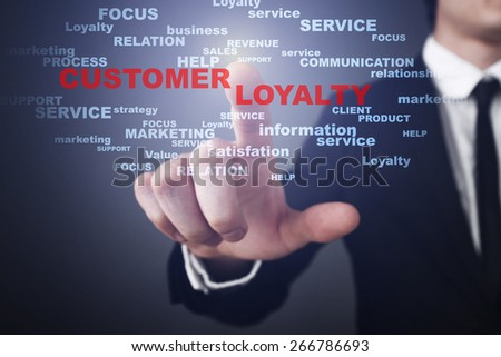 Businessman pressing button on touch screen interface and select customer loyalty. Business concept.