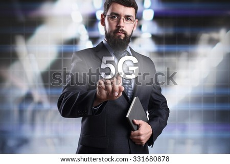 Businessman pressing button on touch screen interface and select 5G. Business concept. Internet concept. - stock photo