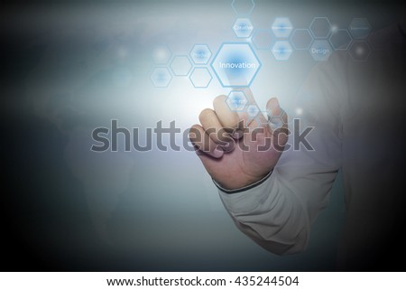 Businessman pressing button on touch screen interface and select  innovation. business concept.