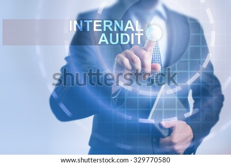Businessman pressing button on touch screen interface and select Internal audit. Business, internet, technology concept. - stock photo