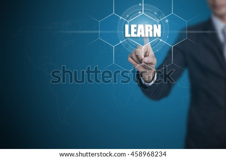 Businessman pressing button on touch screen interface and select Learn, Business concept. - stock photo