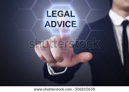 """Businessman pressing button on touch screen interface and select """"Legal advice"""". Business concept. Internet concept. - stock photo"""