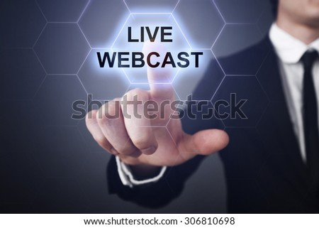 "Businessman pressing button on touch screen interface and select ""Live webcast"". Business concept. Internet concept. - stock photo"