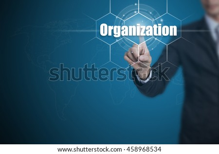 Businessman pressing button on touch screen interface and select Organization, Business concept. - stock photo
