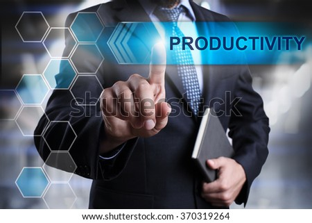 "Businessman pressing button on touch screen interface and select ""Productivity"". Business concept. Internet concept. - stock photo"