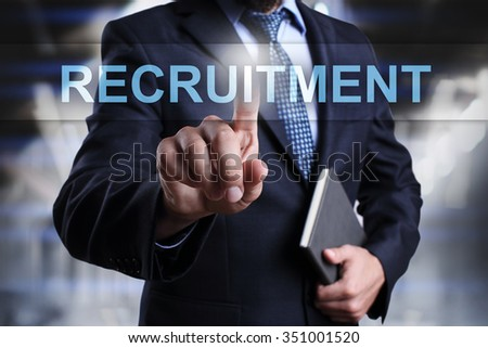 Businessman pressing button on touch screen interface and select recruitment.  - stock photo