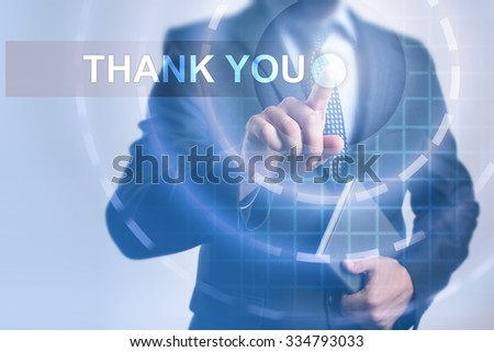 Businessman pressing button on touch screen interface and select Thank you. Business, internet, technology concept.