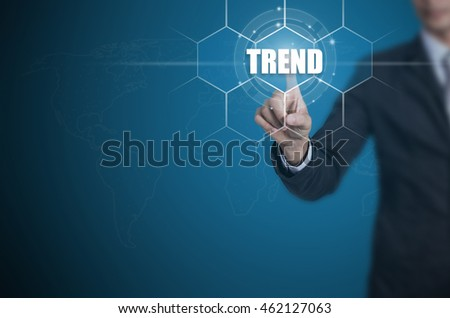 Businessman pressing button on touch screen interface and select Trend, Business concept.