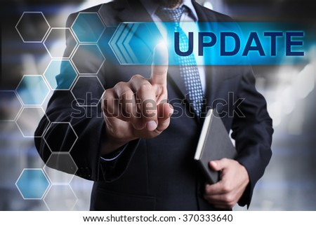 """Businessman pressing button on touch screen interface and select """"Update"""". Business concept. Internet concept. - stock photo"""