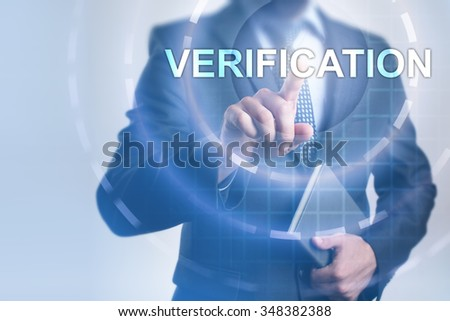 Businessman pressing button on touch screen interface and select Verification. Business, internet, technology concept. - stock photo