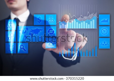 businessman pressing button on virtual screen. business concept.