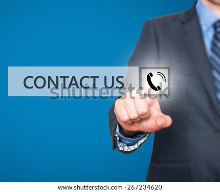 Businessman pressing button on virtual screens. Isolated on blue. Business, technology and internet concept - Stock Image - stock photo