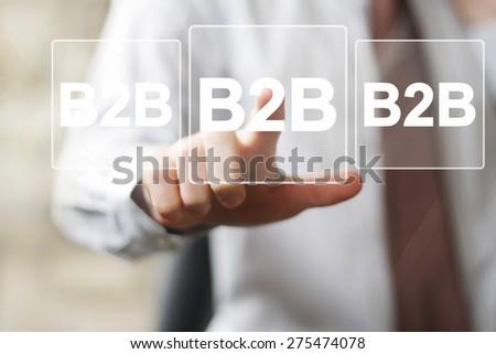 Businessman pressing button web b2b icon - stock photo