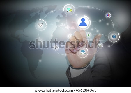 businessman pressing button with contact on virtual screens -business, technology, internet and social networking concept