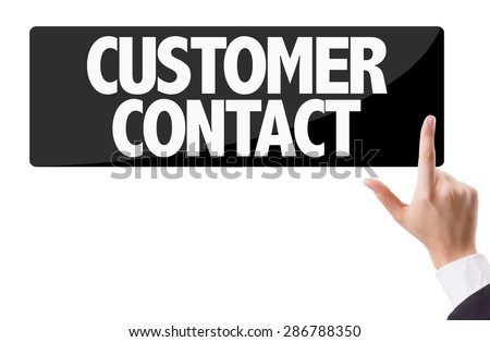 Businessman pressing button with the text: Customer Contact - stock photo