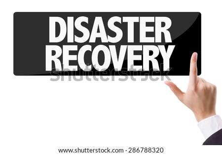 Businessman pressing button with the text: Disaster Recovery - stock photo