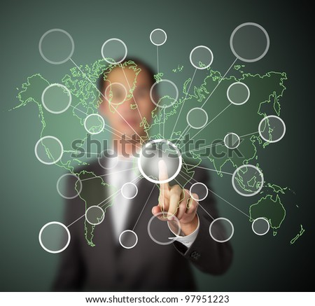 businessman pressing  centric link touchscreen button on green world