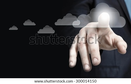 Businessman pressing cloud icon on media screen