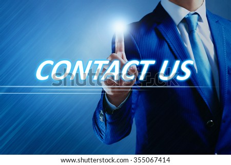 Businessman pressing contact us button on virtual screen. Internet and networking concept. - stock photo