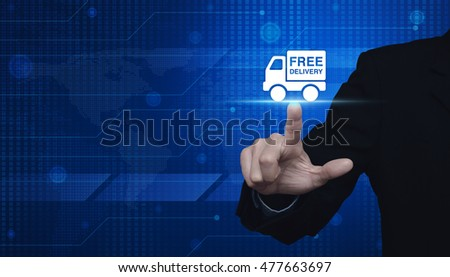 Businessman pressing free delivery truck icon over digital world map, Logistic transportation concept, Elements of this image furnished by NASA