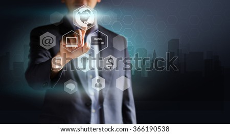 Businessman pressing Internet computer icon. Design concept of Business and technology. Social network. E-commerce. Technology and Communication.