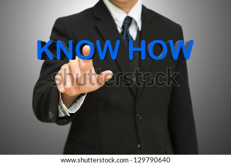 Businessman pressing know how 3d text, Business concept - stock photo