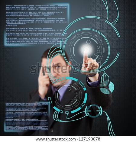 Businessman pressing modern buttons on a virtual interface - stock photo