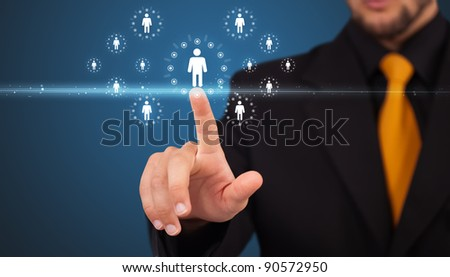 Businessman pressing modern social buttons on a virtual background - stock photo