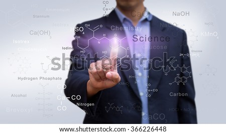 Businessman pressing molecular chemistry sign. Chemistry science and research concept. - stock photo