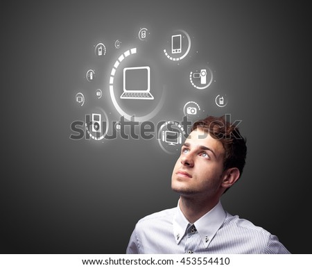 Businessman pressing multimedia type of modern buttons with virtual background - stock photo