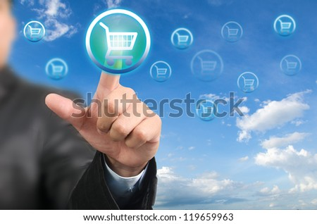 Businessman pressing on cart button