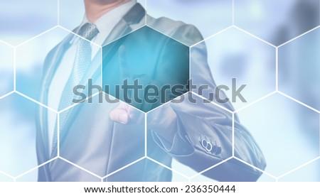 businessman pressing on digital screen, editable business content - stock photo