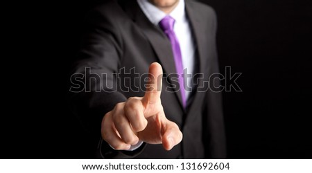 Businessman pressing on empty space - stock photo