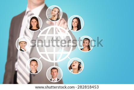 Businessman pressing on holographic screen with human faces