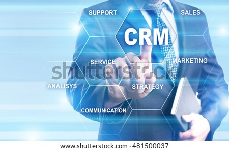 Businessman pressing on virtual screen and select CRM concept.